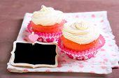 foto of red velvet cake  - Pink velvet cakes with cream topping on napkin  - JPG