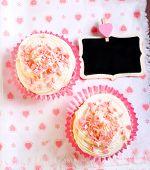 stock photo of red velvet cake  - Pink velvet cakes with cream topping on napkin  - JPG