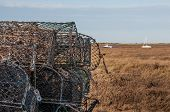 picture of lobster boat  - A stack of lobster pots by the sea ready to used again - JPG