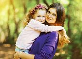 stock photo of children walking  - Portrait lovely mother and child together outdoors