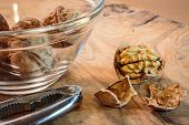 picture of walnut  - Cracked walnuts nutcracker and walnuts in a bowl - JPG