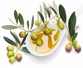 image of olive branch  - ceramic spoon filled with olive oil and green olives decorated with an olive - JPG