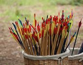 image of archery  - A Wicker Basket Holding Colourful Archery Arrows. ** Note: Visible grain at 100%, best at smaller sizes - JPG