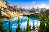 stock photo of rocky-mountains  - Landscape view of Moraine lake and mountain range at sunset in Rocky Mountains Canada - JPG