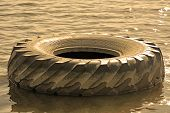stock photo of trash truck  - Tire of the big truck at the water - JPG