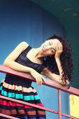 stock photo of mini dress  - portrait of a beautiful young woman in a striped dress bright - JPG