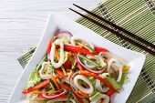 stock photo of squid  - Salad with vegetables and squid rings close - JPG