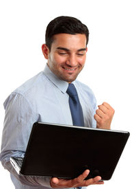 picture of arab man  - A happy excited business man with holding a laptop and showing a fist of success or victory - JPG