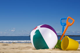 image of beach-ball  - Day at the beach with a beach ball spade and bucket in the foreground - JPG