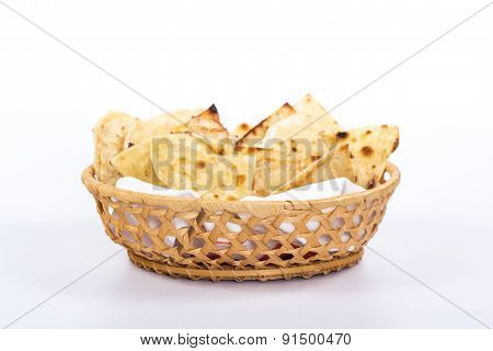 isolated basket plate of traditional eastern flat bread