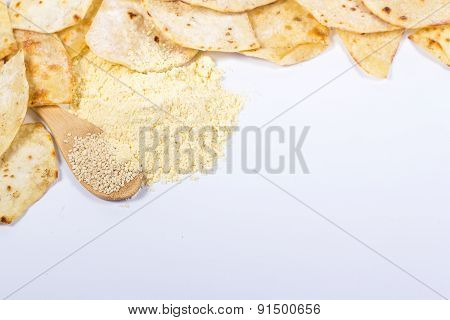 copy space with traditional eastern flat bread, flour and sesame