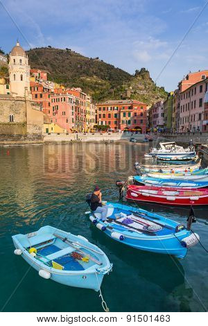 VERNAZZA, ITALY - APRIL 12, 2015: Beautiful architecture of Vernazza town at the Ligurian sea in Italy. Vernazza is one of five famous coastline villages in the Cinque Terre National Park, Liguria.