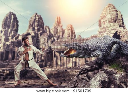 Karateka fights with crocodile