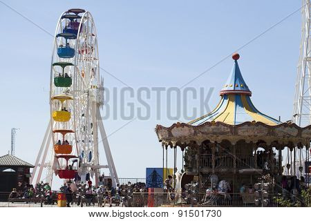 BARCELONA, SPAIN - MAY 2, 2015:  Ferrish-wheel and carousel in the Amusement Park on Mount Tibidabo in Barcelona, Catalonia, Spain