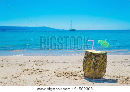 Pineapple Drink And Boat On A Clear Day