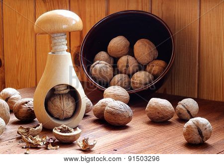 Wooden Nutcracker And Walnuts On A Wooden Table