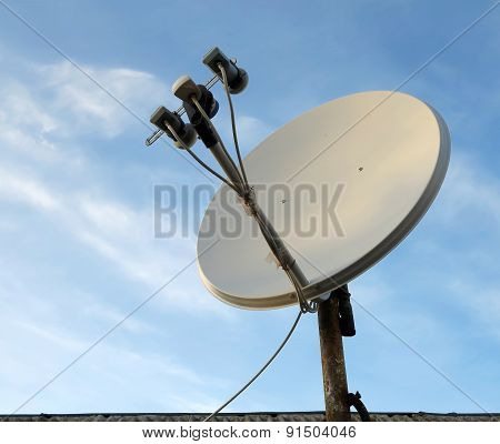 Satellite Dish Antenna Over Blue Sky Background