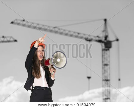 Woman-builder in hardhat screaming