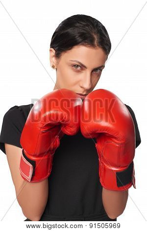 Serious business woman wearing boxing gloves