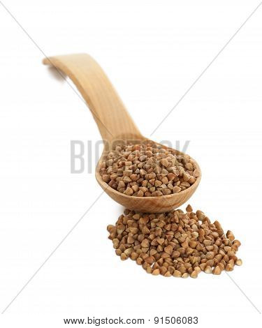 Buckwheat In Wooden Spoon On White.