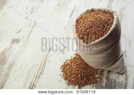 Buckwheat In Linen Sack Into Wooden Decking.