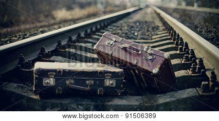 Two Vintage Suitcases Left On Railway Tracks.