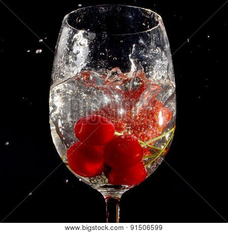 Cherries And Strawberry In Glass Of Water