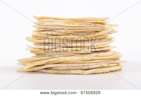 isolated stack of slice of flat white bread