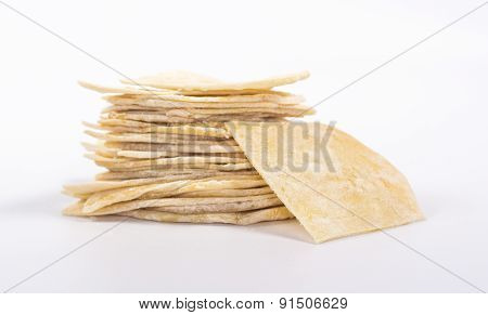 isolated stack of flat white bread and one slice