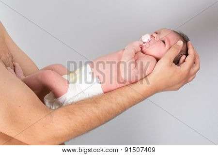 Cute Baby Sleeping On The  Her Father Arm And Baby-soother