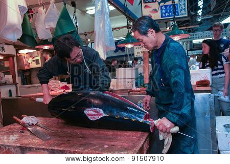 Fresh Tuna main cut by professional Japanese tuna handlers at Tsukiji