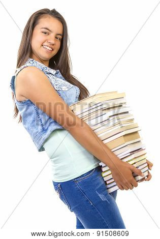 Young student girl holding a stack of book