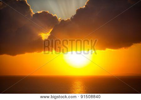 Beautiful sun over ocean, orange sunrise