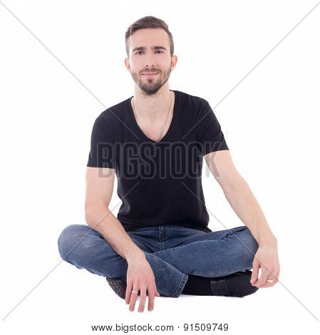 Happy Young Man Sitting On The Floor Isolated On White