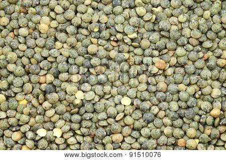 French green lentils (lentilles du Puy) background
