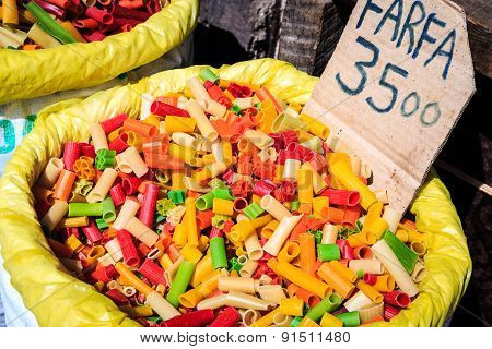 Big Bags With Colorful Pasta For Sale On A Market