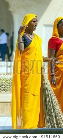 Woman Of Fourt Class In Brightly Colored Clothing Cleans The Amber Palace