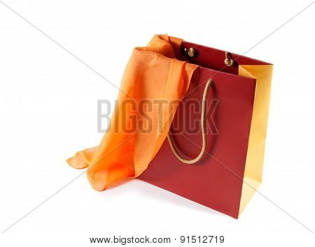 Red-orange Gift Bag And   Orange Silk Scarf Isolated On White
