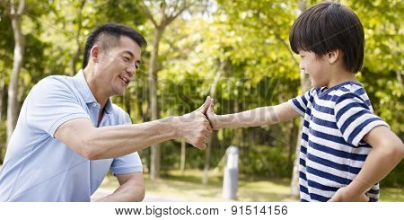 Asian Father And Son Making A Deal