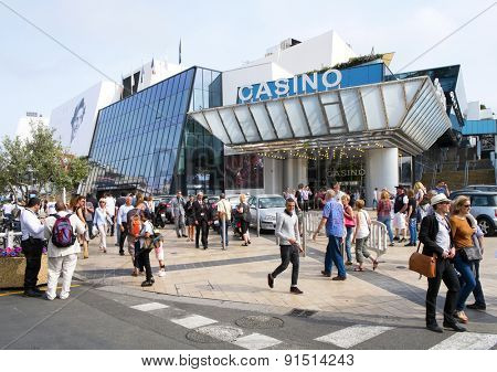 CANNES, FRANCE - MAY 14: People around the Casino and the Palais des Festivals, in the Promenade de la Croisette, during the 68 edition of the Cannes Film Festival on May 14, 2015 in Cannes, France