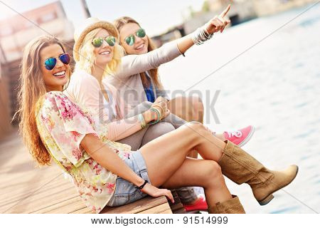 a picture of group of friends hanging out in the city