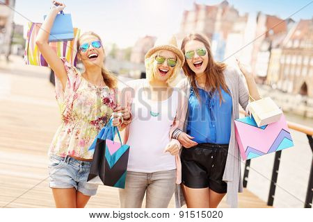 A picture of group of friends shopping in the city