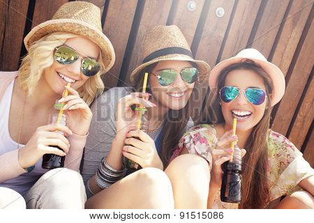 Group of friends drinking cocktails in the city
