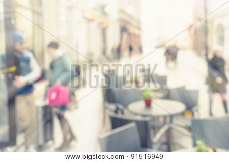 City Street With People In The Spring In A Blurred
