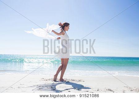 Peaceful brunette enjoying the air at the beach