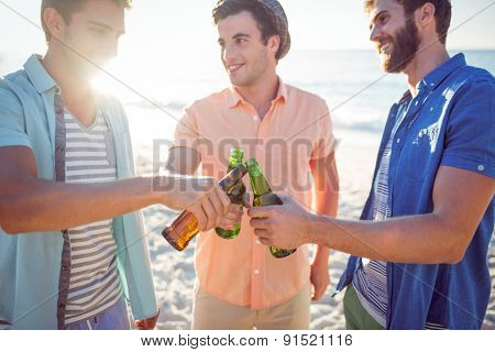 Handsome men toasting at the beach