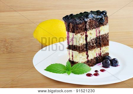 Cocoa Sponge Cake With Lemon Icing And Blueberry Sauce
