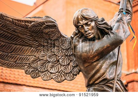 Statue Of Archangel Michael With Outstretched Wings Before Red C