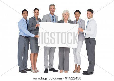 business people holding blank board in office