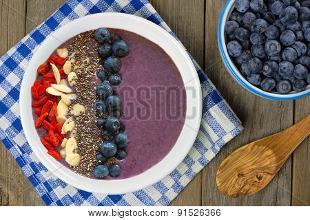 Blueberry smoothie bowl overhead table scene